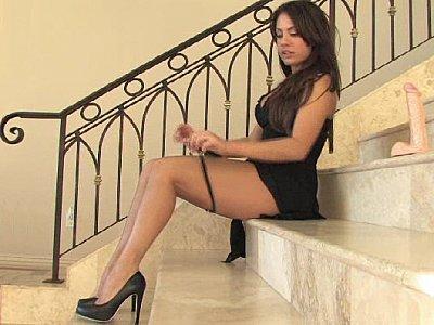 Babe in dress spreading & dildoing
