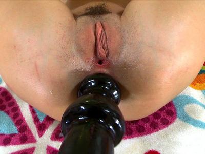 Cassandra Nix sticks huge anal toy deep in her rectum