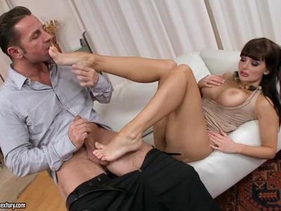 Aletta Ocean uses her sexy feet to wank cock