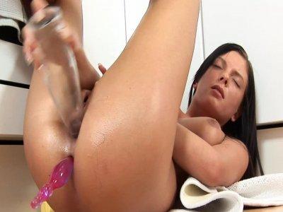 Brunette Monika in action of double penetration using dildo and glass bottle