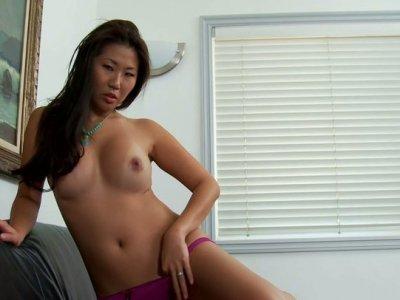 Sweet asian chick Beti Hana kneels down to suck cock