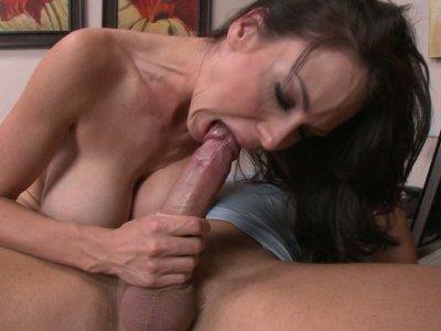 Trashy slut McKenzie Lee fucks her boss in an office riding his cock hard