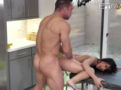 Busty Asian is riding his dick hard in the kitchen