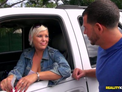Busty cute milf gets picked up in the car wash and flashes her tits