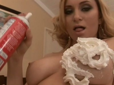 Kinky Aiden Starr covers her boobs with cream and licks it up