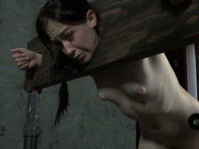 Cheyenne Jewel locked in the pillory and stuffed a long bar in her pussy