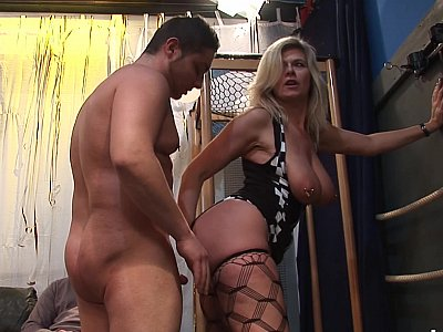 Busty mature satisfying a group of men