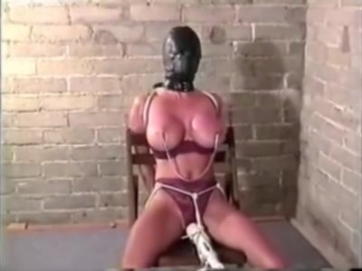 Woman Locks Herself Into Leather Hood