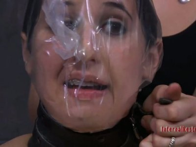 Two brunettes entertain each other in BDSM style