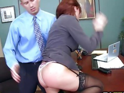 Britney Amber sucks Bill Baileys cock lying in her desk