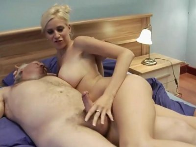 Attractive young woman has sex with old man in bed