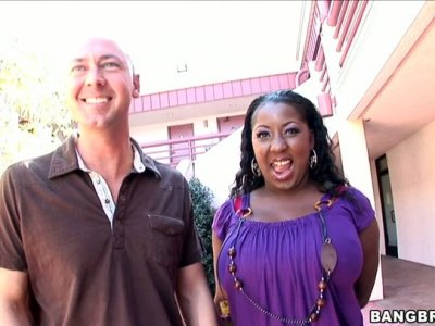 Dirty dark skinned slut Luxury Amore demonstrates her huge boobs and gives a head